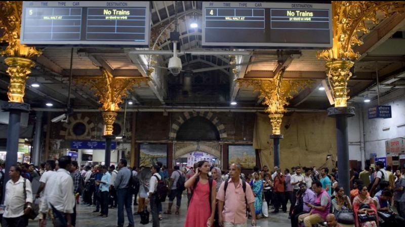 Water-logging on railway tracks due to heavy rains and high tide on Saturday affected movement of trains on Thane and Panvel sections of the Central Railway (CR) in Mumbai, leaving thousands of passengers stranded at various stations. (Photo: ANI)