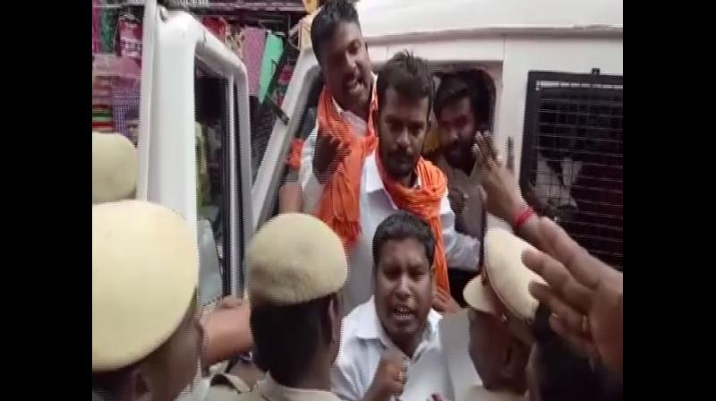 Activists of Maruthu Thiruvar Makkal Kazgham on Sunday staged a protest outside the Meenakshi Amman Temple here over a missing statue in the temple in Madurai in Tamil Nadu. (Photo: ANI)