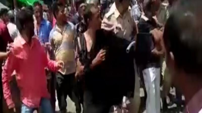 A man was allegedly thrashed by a mob over suspicion of being a child-lifter in Kanpur's Om Purva area in Uttar Pradesh. (Photo: ANI)