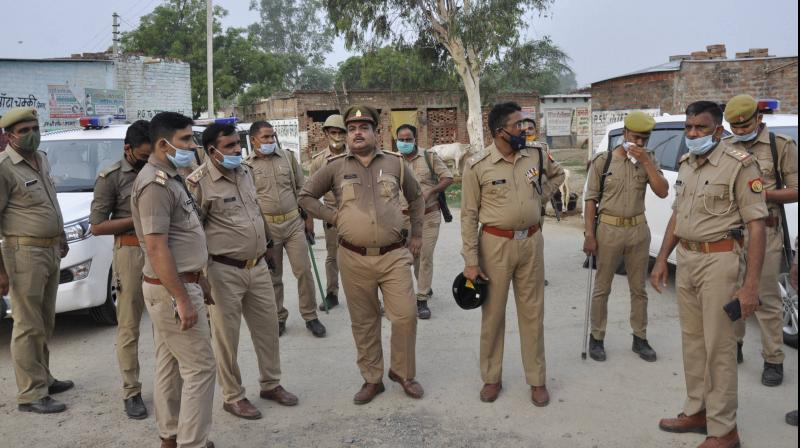 Police personnel at Bikhru village after encounter with criminals in Kanpur. PTI photo