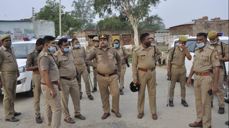 Police personnel at the residence of criminal Vikas Dubey after the encounter in Bikaru village where 8 cops lost their lives in Kanpur. PTI photo