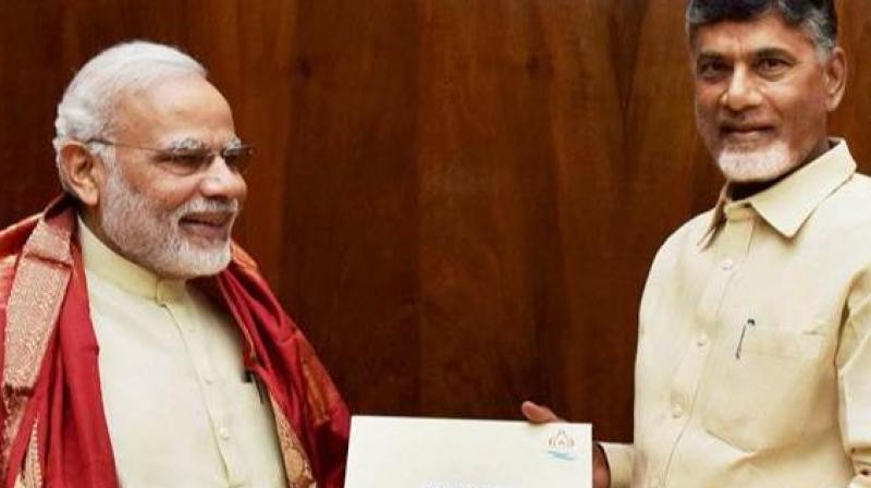 Prime Minister Narendra Modi speaks to Andhra Pradesh Chief Minister Chandrababu Naidu on Thursday afternoon. (Photo: PTI)