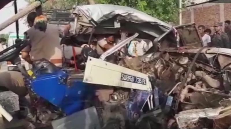 The sand-laden tractor-trolley hit the overloaded jeep carrying nearly 20 people of a family at a cross road near Ganjrampur village. (Photo: ANI/Twitter)