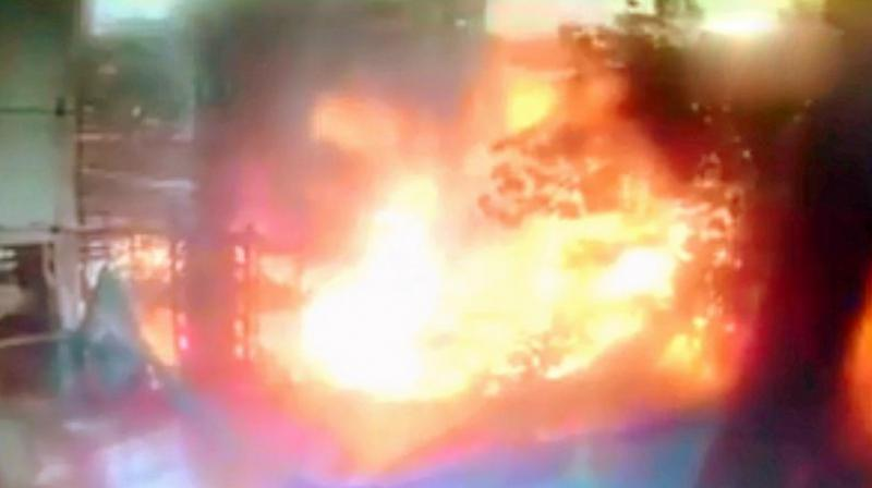 The new video, shot from a camera placed at a building across the road from the crash site, shows the plane tumbling into the steel girders that had been erected at the construction site. (Photo: Screengrab | ANI)