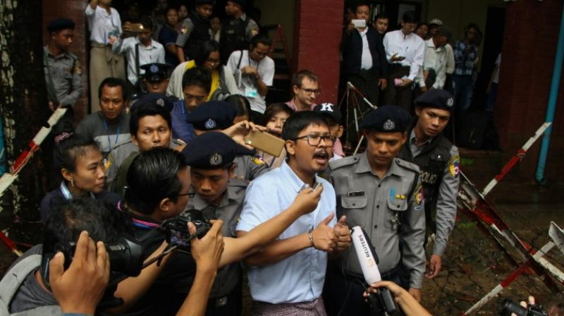 Detained journalist Wa Lone speaks to the media after exiting the court. (Photo: AFP)