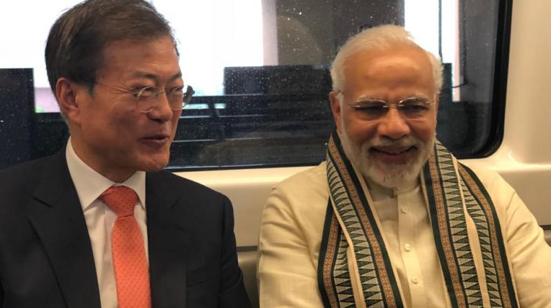 Prime Minister Narendra Modi with President Moon Jae-in, aboard the Delhi Metro, travelling to the inauguration of the mobile factory of Samsung in Noida. (Photo: ANI/Twitter)