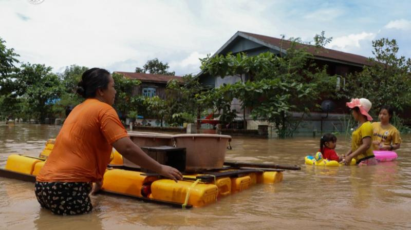The floods have sent panicked residents fleeing for dry ground with children perched on their shoulders and few belongings in tow. (Photo: AFP/Twitter)