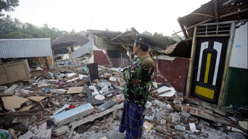 A man inspects the ruin of his house destroyed by an earthquake in North Lombok. (Photo: AP)