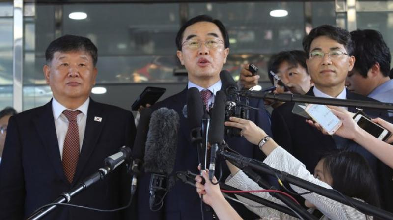 South Korean Unification Minister Cho Myoung-gyon (center) speaks to the media before leaving for the border village of Panmunjom to attend South and North Korean meeting, at the Office of the South Korea-North Korea Dialogue in Seoul, in this June 1, 2018, file photo. (Photo: AP)