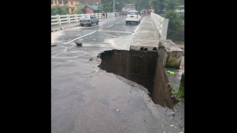 Traffic movement from Kandaghat to Chail halted after a part of a bridge collapsed following heavy rainfall. (Photo: Twitter | ANI)