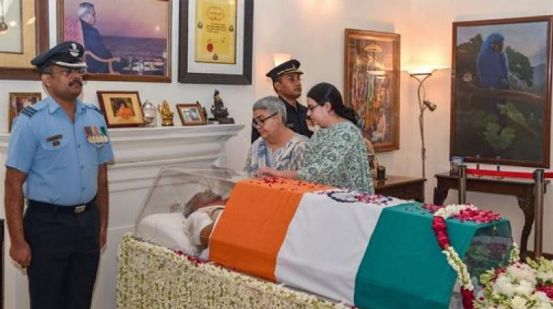 Namita Kaul Bhattacharya, adopted daughter, and Niharika Bhattacharya, grand daughter, pay tribute to former prime minister Atal Bihari Vajpayee, at his Krishna Menon Marg residence, in New Delhi. (Photo: PTI)