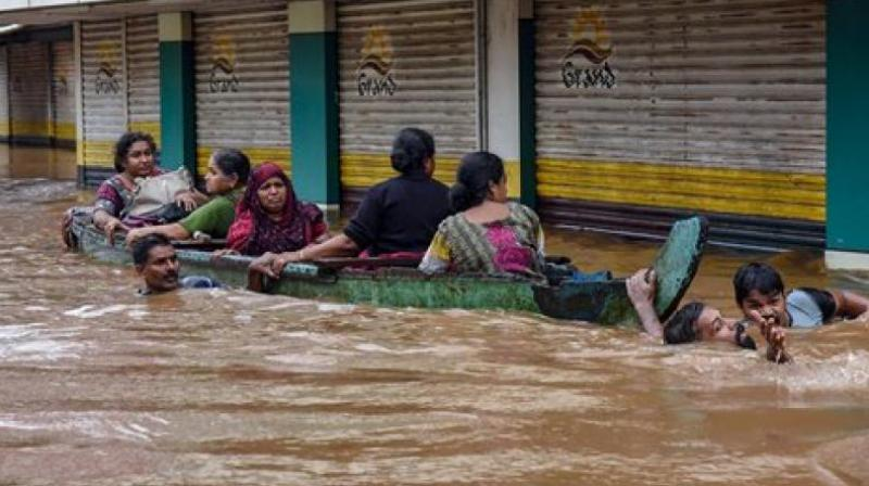 People being rescued from a flood-affected region following heavy monsoon rainfall, in Kochi. (Photo: PTI)
