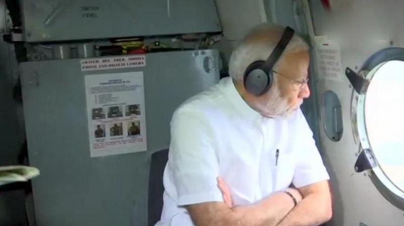 Prime Minister Narendra Modi conducted aerial survey of flood-hit Kerala where 324 people have died in last nine days. (Photo: Twitter | ANI)