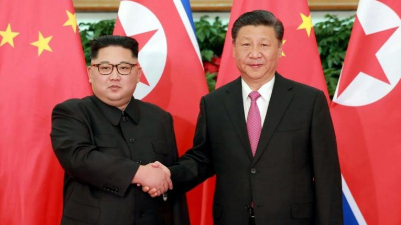 Kim has visited China thrice this year and held talks with Xi on improving cooperation between the two countries and for economic reforms. (Photo: AFP)