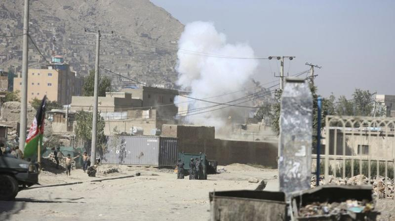 Smoke rises from a house where attackers are hiding in Kabul, Afghanistan, August 21, 2018. (Photo: AP)