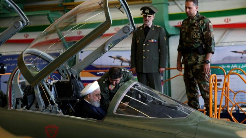 Images on state television showed President Hassan Rouhani sitting in the cockpit of the new 'Kowsar' fourth-generation fighter at the National Defence Industry exhibition in Tehran. (Photo: AFP)
