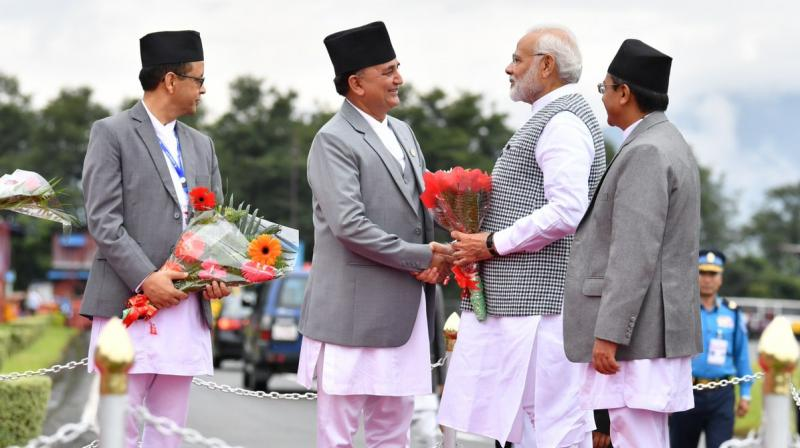 Prime Minister Narendra Modi being welcomed by dignitaries upon his arrival in Nepal. (Photo: Twitter | @PIB_India)