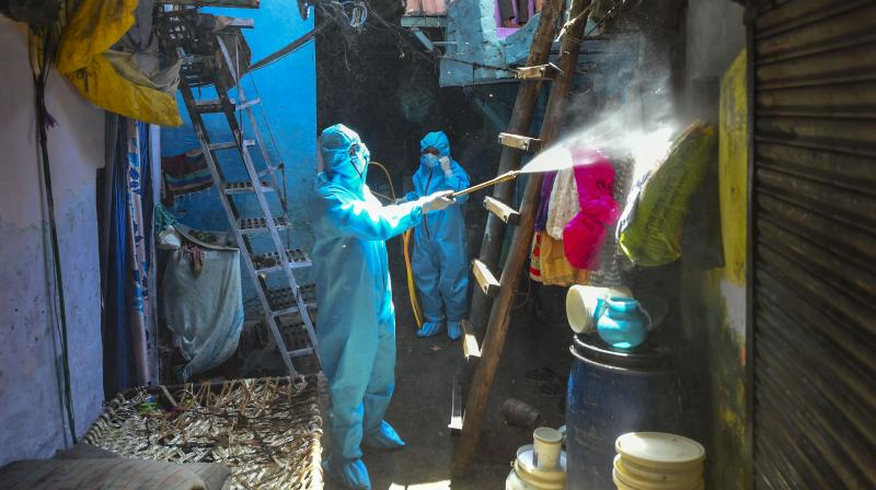MCD workers spray disinfectants at Malka Ganj area amid coronavirus lockdown in New Delhi. PTI photo