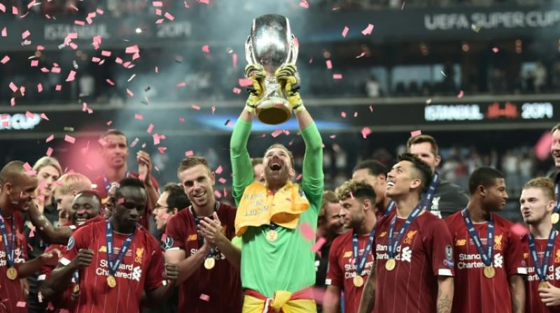 Adrian raises aloft the UEFA Super Cup after his save in the penalty shoot-out allowed Liverpool to beat Chelsea in Istanbul. (Photo:AFP)