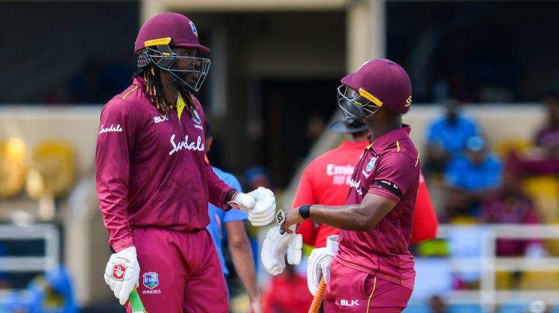 West Indies had won the toss and opted to bat first. The openers Evin Lewis and Chris Gayle had provided a solid base for the team as they put up a 115-run stand. (Photo:AFP)