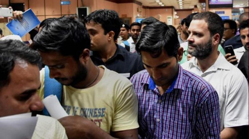 Congress vice-president Rahul Gandhi on Friday was seen waiting in a line in front of the SBI's Parliament Street branch to exchange Rs 4,000 currency notes. (Photo: PTI)
