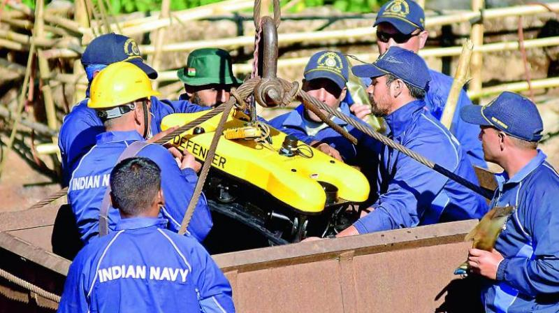 Navy personnel conduct rescue task at the site of the coal mine collapse at Ksan, in Jaintia Hills district of Meghalaya, Monday. (Photo: AP)