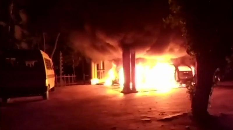 Two cars and a scooter belonging to Swami Sandeepanada Girl's School on the outskirts of Thiruvananthapuram were set on firearound 2:30 am. (Photo: ANI | Twitter)