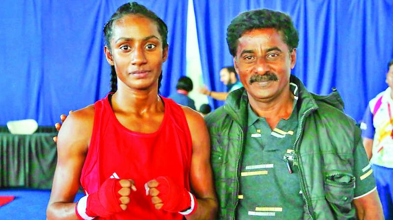 S. Kalaivani with her father M. Srinivasan.