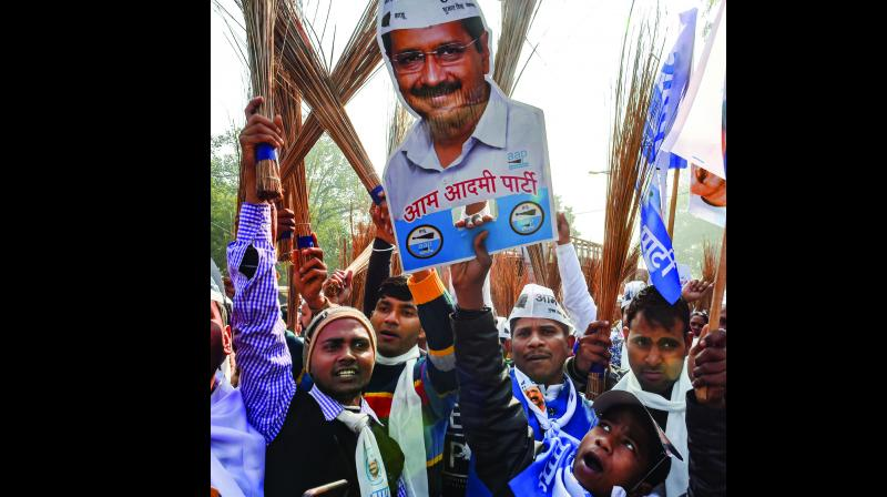 AAP workers during an election campaign at Model Town in New Delhi on Thursday. (Photo: PTI)