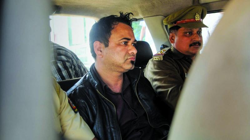 Dr Kafeel Khan, the Uttar Pradesh doctor who was jailed after the death of over 60 children at a government hospital in 2017, being taken away by the UP police, in Mumbai on Thursday.— PTI    Khan was arrested on Wednesday from Mumbai airport for allegedly making inflammatory statements at AMU. (Photo: PTI)