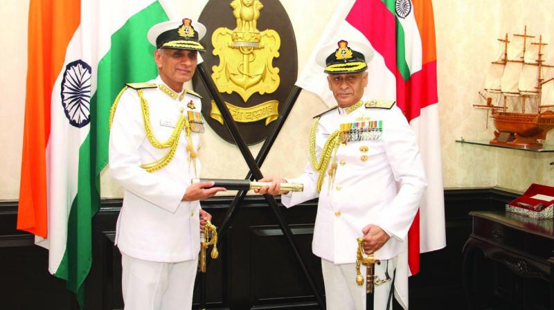 Chief of Naval Staff Admiral Karambir Singh assumes command of the Indian Navy as his predecessor Sunil Lanba looks on in New Delhi on Friday.
