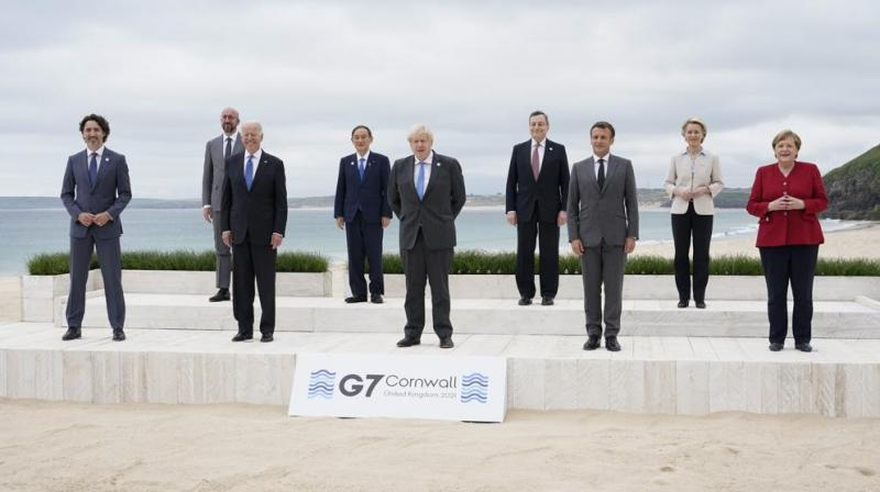 Leaders of the G7 pose for a group photo on overlooking the beach at the Carbis Bay Hotel in Carbis Bay, St. Ives, Cornwall, England, Friday, June 11, 2021. (Photo: AP)