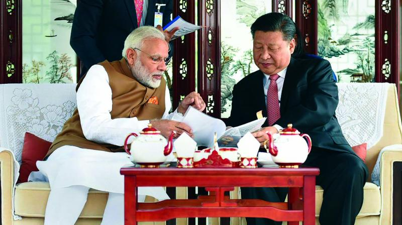 Prime Minister Narendra Modi with Chinese President Xi Jinping on a house boat at Wuhan's East Lake in China. (Photo: PTI)