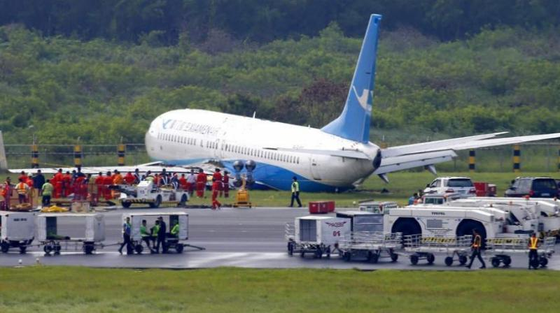 A Boeing passenger plane from China, a Xiamen Air, sits on the grassy portion of the runway of the Ninoy Aquino International Airport after it skidded off the runway while landing Friday, Aug. 17, 2018 in suburban Pasay city southeast of Manila, Philippines. (Photo: AP)