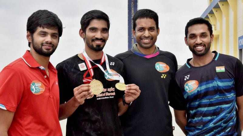 Kidambi Srikanth displays his medals with coach P Gopichand and shuttlers HS Prannoy and B Sai Praneeth. (Photo:AP)