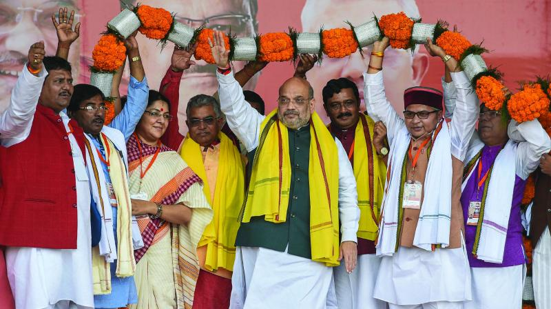Union home minister Amit Shah being garlanded during a rally at Shaheed Minar Ground in Kolkata on Sunday. Soon after delivering his speech at a pro-CAA rally in Kolkata, Mr Shah went to the Kalighat Temple, which is only a few metres away from  West Bengal chief minister Mamata Banerjee's residence. (Photo: PTI)