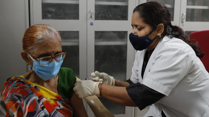 A health worker administers COVID-19 vaccine at Moti Lal Nehru Medical College in Prayagraj. (Photo: AP)