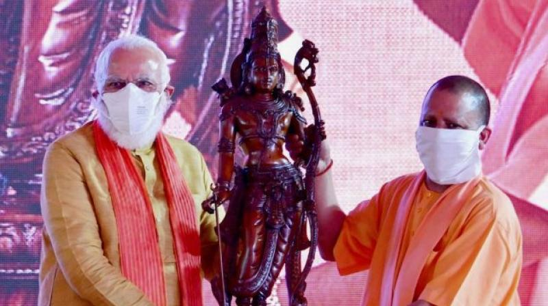 PM Narendra Modi being presented with a memento by Uttar Pradesh CM Yogi Adityanath during the Ayodhya Ram Mandir bhoomi pujan (PTI)