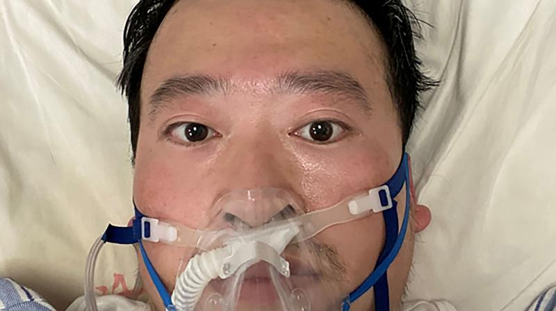 Chinese coronavirus whistleblowing doctor Li Wenliang whose death was confirmed on February 7, lying on a bed at the Wuhan Central Hospital, China. (AFP)