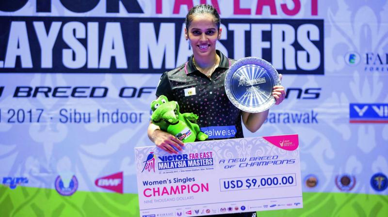 Saina Nehwal poses with the trophy after winning the Malaysia Masters in Sibu, Sarawak, on Sunday. Saina beat Thailand's Pornpawee Chochuwong 22-20, 22-20 in the final. (Photo: AP)