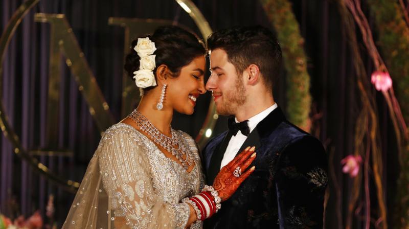 ollywood actress Priyanka Chopra and musician Nick Jonas stand for photographs at their wedding reception in New Delhi. (Photo: AP)