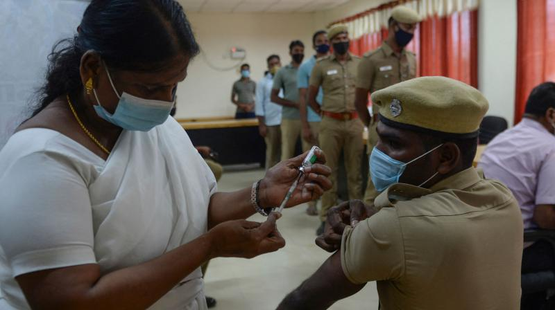 A medical worker inoculates a policeman with a Covishield Covid-19 coronavirus vaccine at a vaccination camp, in Chennai. (AFP)