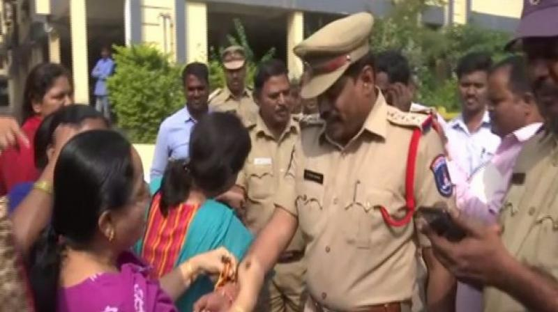People were seen distributing sweets to cops and congratulating them. (Photo: ANI)