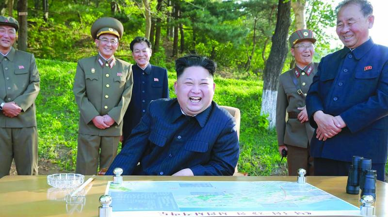 North Korean leader Kim Jong-un watches the test launch of solid fuel Pukguksong-2, a medium-to-long range ballistic missile, at an undisclosed location in North Korea. (Photo: AP)