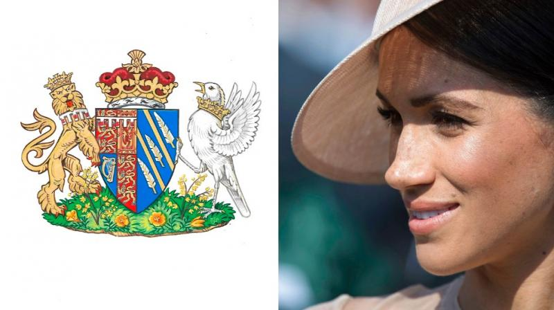 The Coat of Arms for the Duchess of Sussex, as she is now formally known, includes symbols that invoke the former actress' background and look to her future. (Photo: AP)
