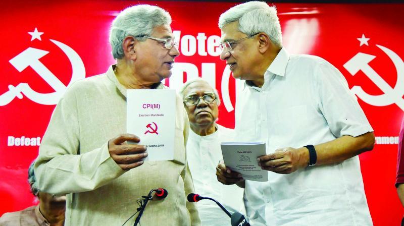 CPM general secretary Sitaram Yechury and former general secretary Prakash Karat at the release of party's manifesto in New Delhi Thursday. (Photo: PTI)