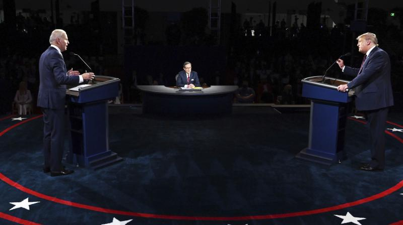 President Donald Trump and Democratic presidential candidate former Vice President Joe Biden participate in the first presidential debate Tuesday, Sept. 29, 2020, at Case Western University and Cleveland Clinic, in Cleveland. AP