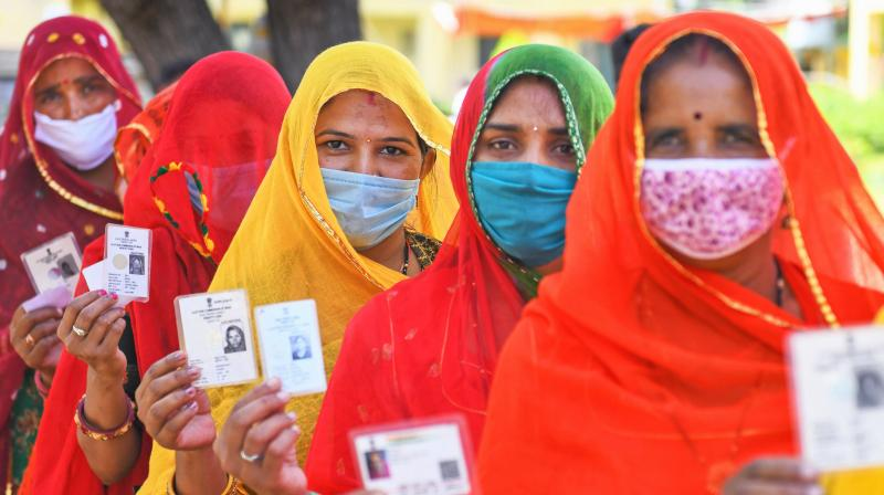 Women wait in long queues to cast their vote at a polling station during Panchayati Raj elections, amid the ongoing coronavirus pandemic, at Jhala ki Chauki village near Beawar, Monday, Sept. 28, 2020. (PTI Photo)