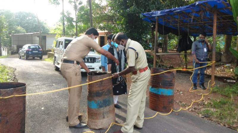 Police barricading an area in a panchayat in Ernakulam district which has been declared as containment zone