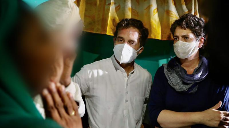 Congress leaders Priyanka Gandhi Vadra and Rahul Gandhi meet the family members of a 19-year-old Dalit woman who died after being allegedly raped two weeks ago, at Bulgadi village in Hathras, Saturday, Oct. 3, 2020. (PTI Photo)